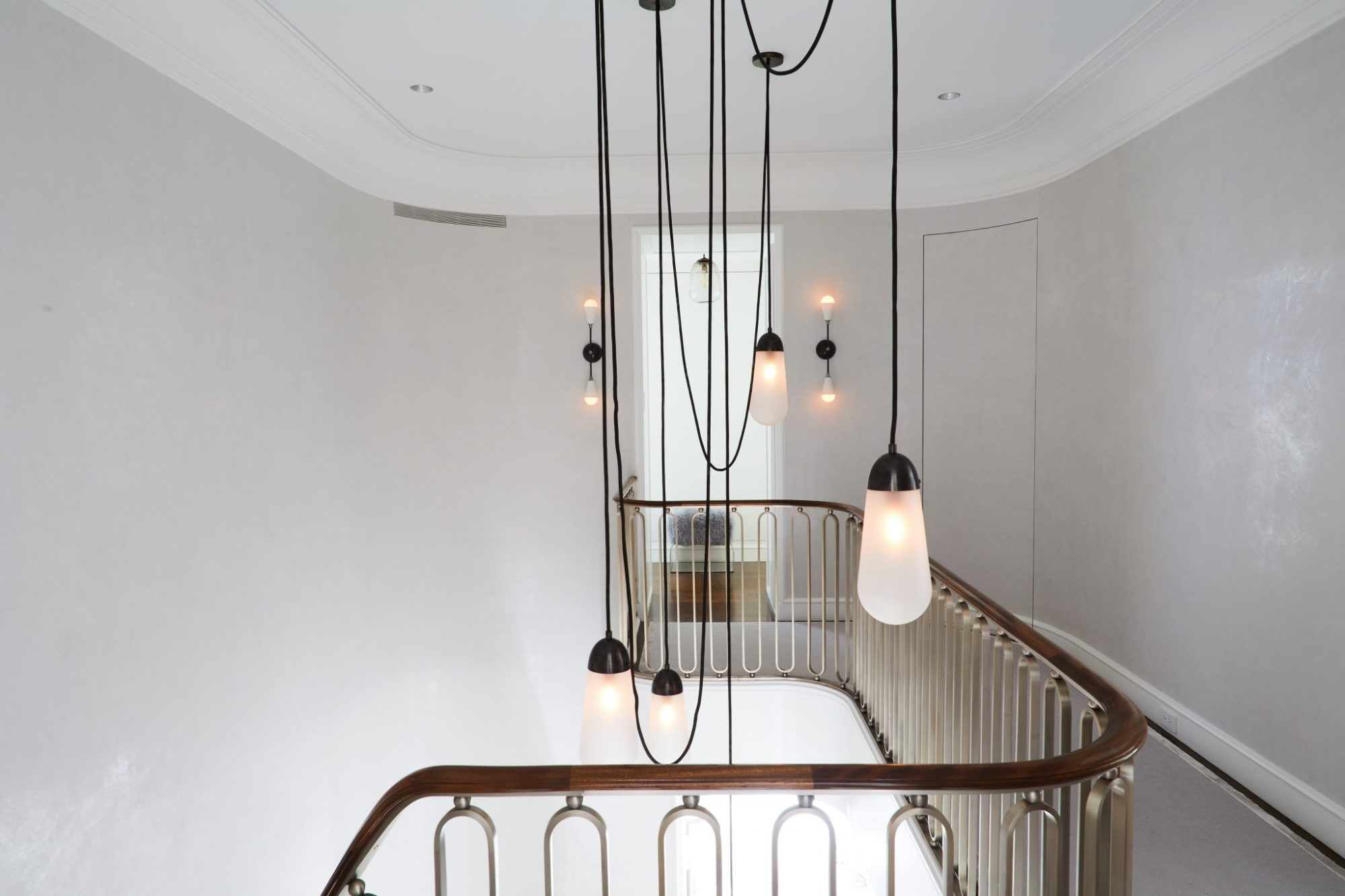 Apparatus Lariat collection pendants in Park Avenue Foyer.jpg