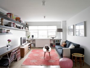 wide oak flooring and white walls to maximize light and modernize a small apartment.