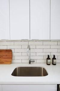 sleek stainless appliances for a modern feel.