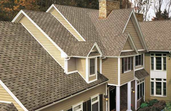 Asphalt Shingles on a high pitch traditional style home.