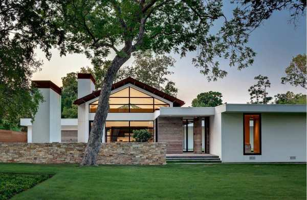White TPO Roofing Membrane on a Modern Ranch Style Home