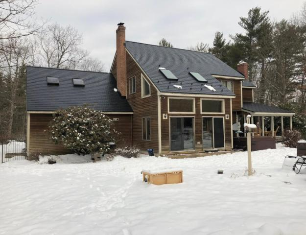 Metal roof fights ice dams and snow