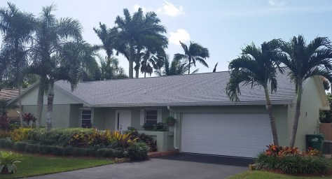 White dimensional shingle roof in Kendall with ridge vents