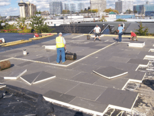 "The roof insulation panels were ""walked-in"" immediately following placement and periodically ""rolled"" with a counterweight to ensure a satisfactory bond to the deck."
