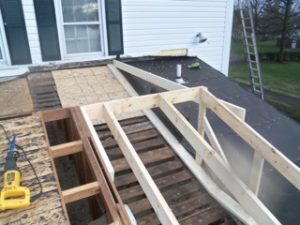 Thrush & Son had to make several changes to the home, including removing the box gutters, cutting off the rafter tails and installing new fascia board.