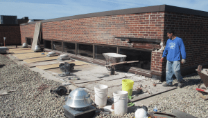 PHOTO 3A: The new roofing at SD 73 Elementary North was encroaching on this clerestory sill and required that it be raised. As part of this project, the steel lintel was exposed. It was prepped, primed and painted and new through-wall flashing was installed.