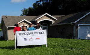 From left to right: Bobby Shifteh, Jasper Contractors' business development manager, and Arielle Dysart, chief operating officer, pose with Paul and Colette Singrossi in front of their newly reroofed home in Winter Springs, Fla.