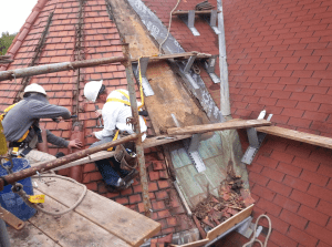 As the clay-tile roof covering was removed, the materials of the substrate were revealed and conditions were assessed.