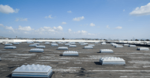 As part of the project, Highland Commercial Roofing changed out 295 old skylights and smoke-vent skylights across the roof, replacing them all with new UL793-compliant smoke-vent skylights. Photo courtesy of SKYCO Skylights.