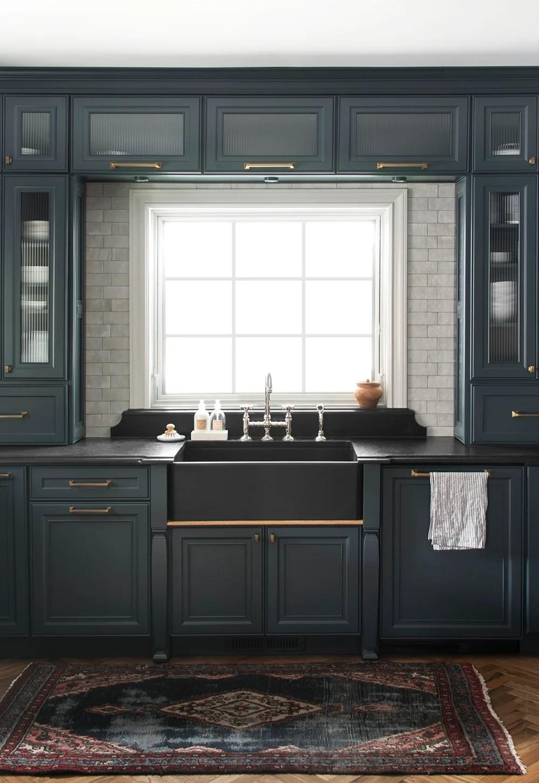 dark kitchen cabinets that frame window