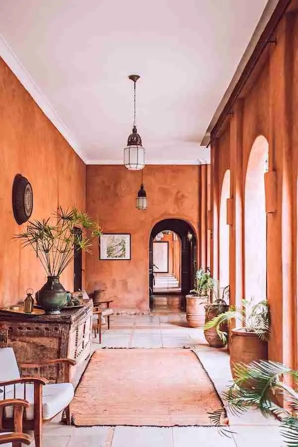 coral Moroccan interior with greenery