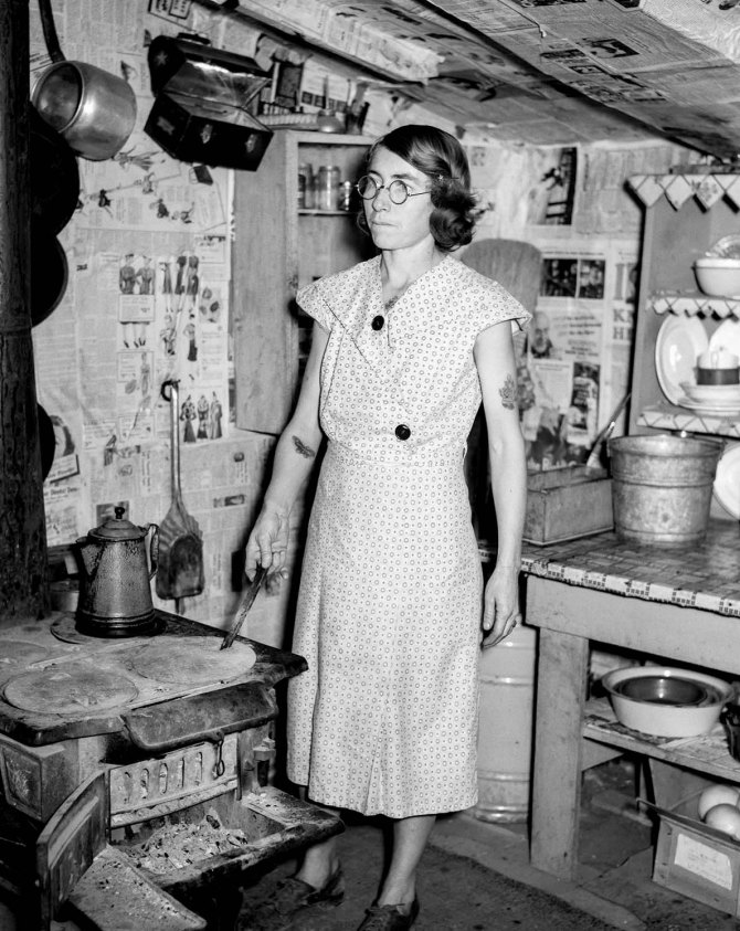 Wife of man on relief, inside of shanty on city dump. Herrin County, Illinois 1939.