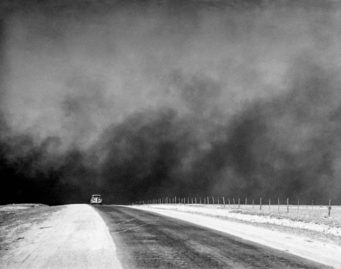 Heavy black clouds of dust rising over the Texas Panhandle, Texas. 1936.