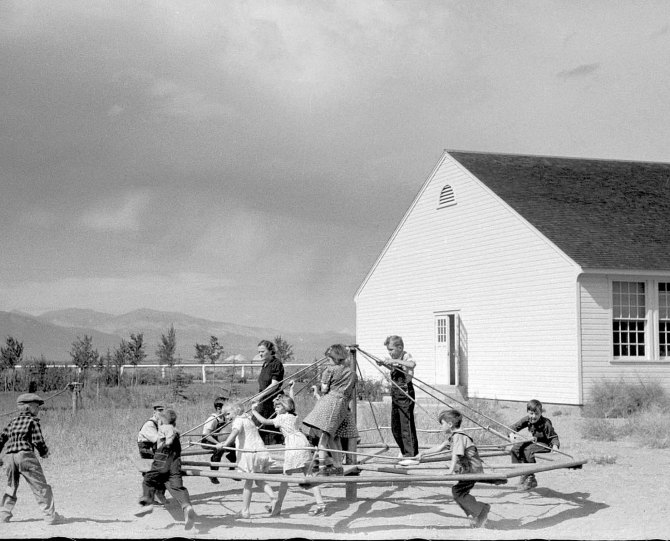 Children of resettlement families in schoolyard, community building at San Luis Valley Farms. Alamosa, Colorado. October, 1939.