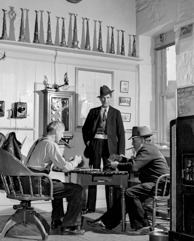 Playing cards in firehouse.Carson City, Nevada. 1940.