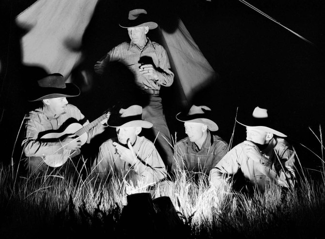 Cowhands singing after day's work. Quarter Circle 'U' Ranch roundup. Big Horn County, Montana. 1939.