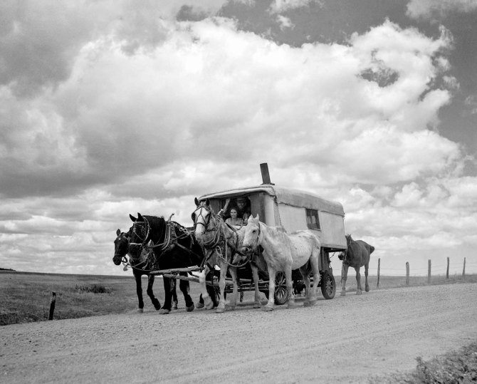 America's internal refugees; a modern covered wagon family going west looking for work. Pennington County, South Dakota 1936