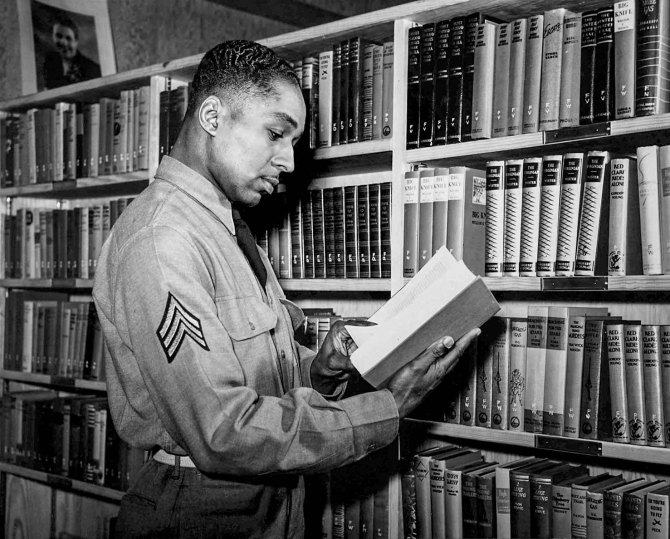 Sgt. Frank Williams, 41st Engineers, in library. Fort Bragg, North Carolina. 1942.