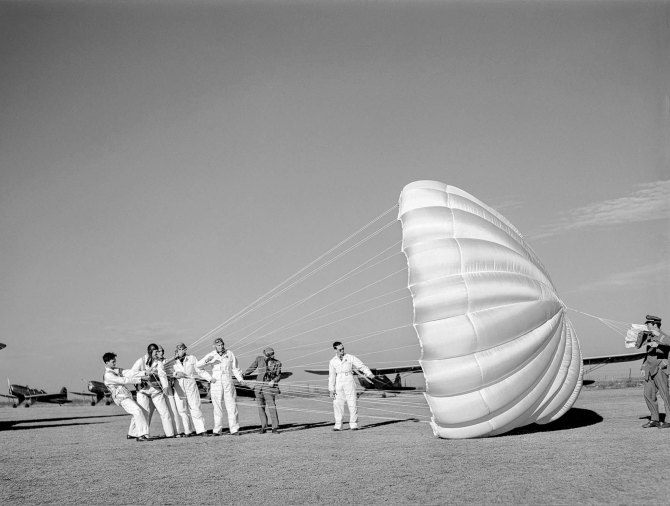 Instructor explaining operation of parachute to student pilots. Meacham Field, Fort Worth, Texas. January 1942.