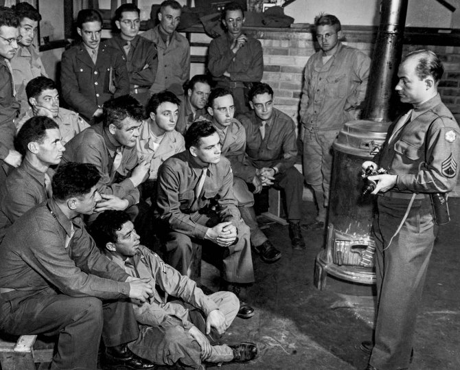 Staff Sgt. Arthur Rothstein (right) with Army Signal Corps photographer trainees at Fort Crowder, Missouri. Soon after he was promoted to Lieutenant. 1943.