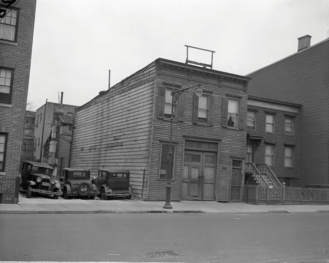 Old buildings, across the street from the Williamsburg Houses, similar to those torn down for the new housing.1939.