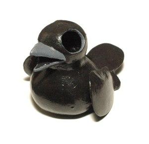 black corvid gourd sculpture