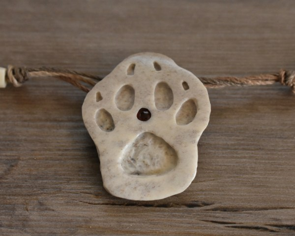 wolf paw print bone carving necklace
