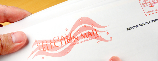 """An envelope that says """"Official Election Mail."""""""