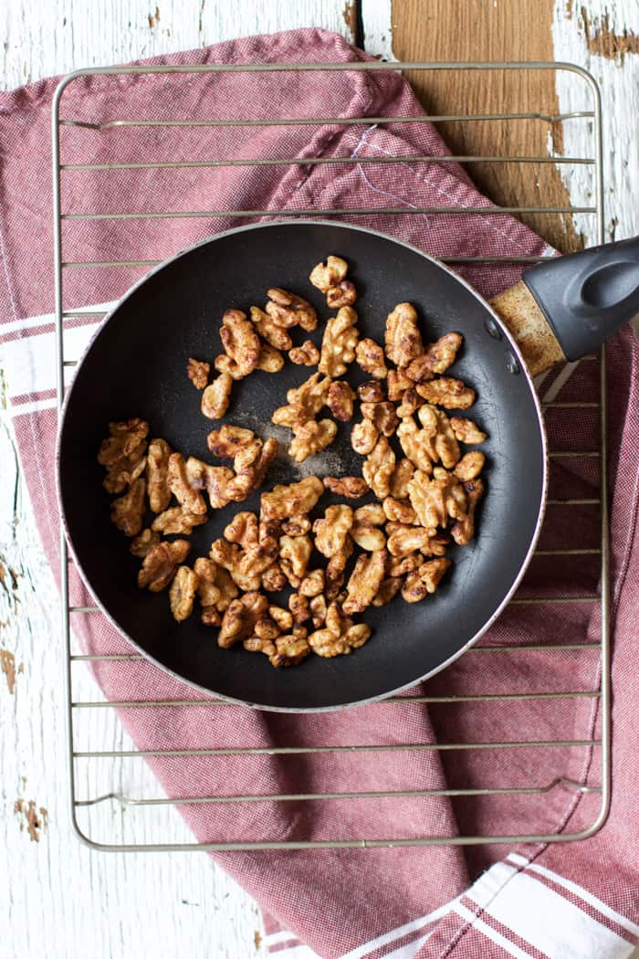 Cinnamon Maple Cayenne Toasted Walnuts - All the yummy spicy-sweet toasted goodness you could ever want, and so easy too. All you need: raw walnuts, maple syrup, cinnamon and cayenne. Come on over to Roots and Radishes for the recipe! | rootsandradishes.com