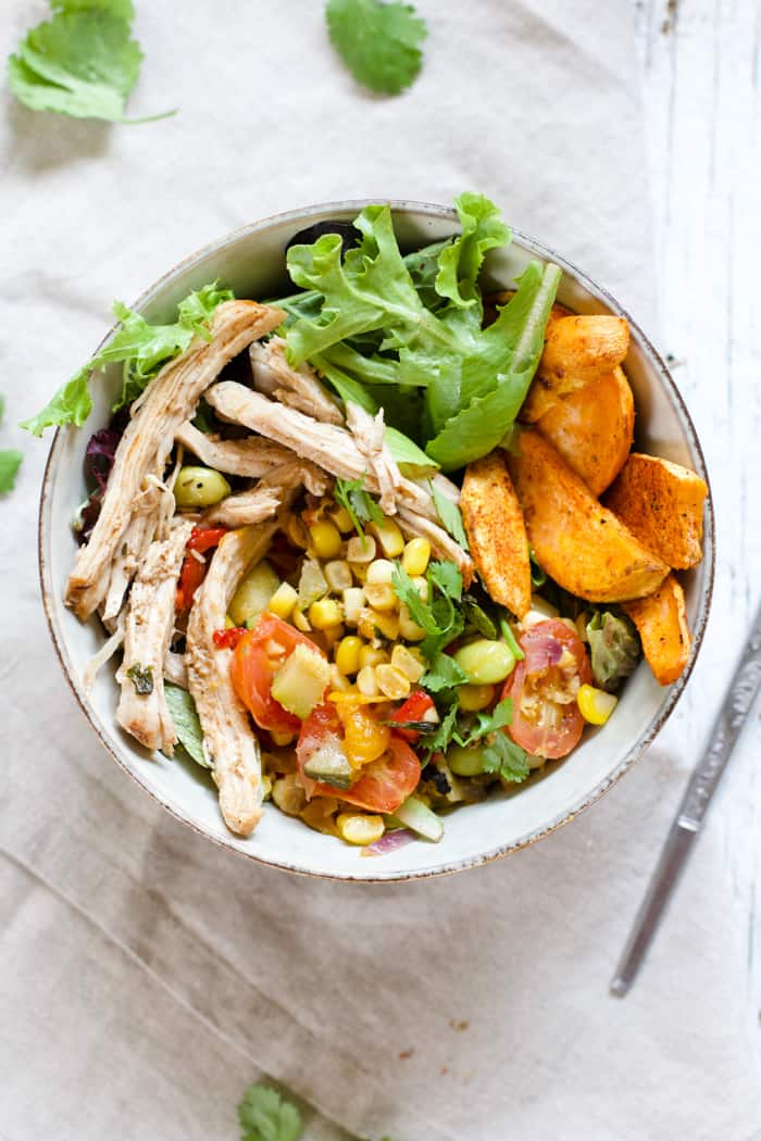 Summery Pulled Pork and Veggie Bowls - OMG these bowls embody summer at its finest! Smokey and spicy pulled pork, sautéed summer veggies, and roasted sweet potatoes, all combined in a big ol' bowl. So flavorful! | rootsandradishes.com