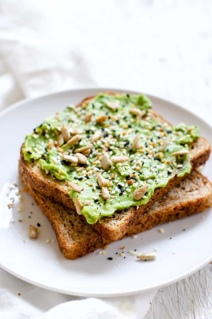 "Everything Spice Avocado Toast - OMG, ""everything"" spice on avocado toast is genius! Sprouted grains bread, mashed avocado, ""everything"" spice blend, sunflower seeds. Simple and delicious! 