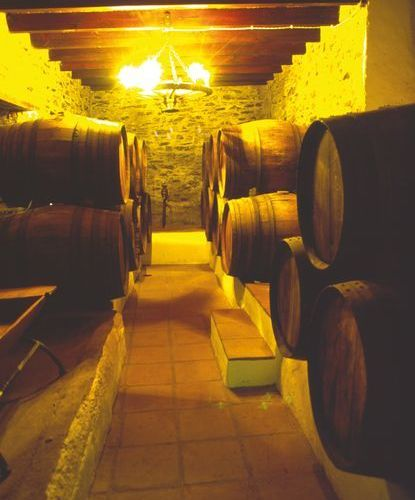 Skill and patience; the ageing of the local wines in barrels.