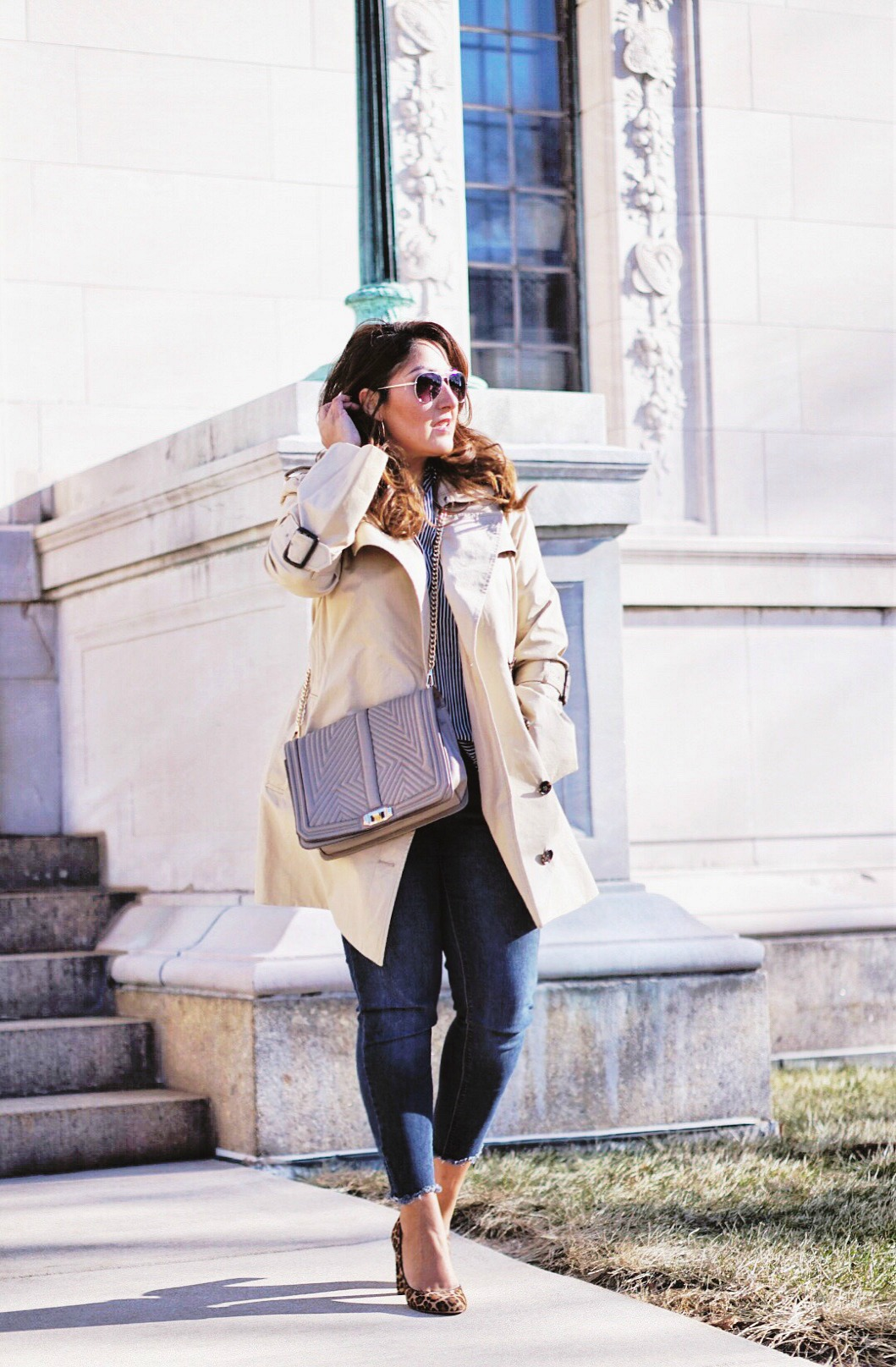 Styling the trench coat for a casual look.