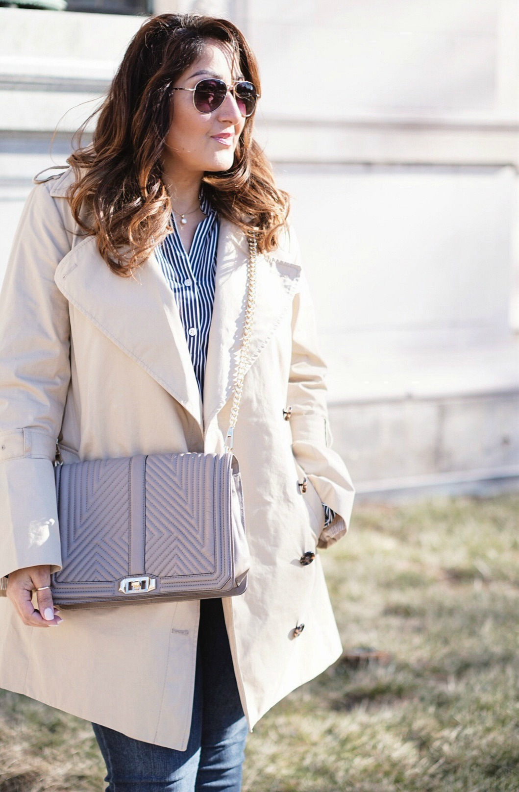 The trench coat for a casual outfit.