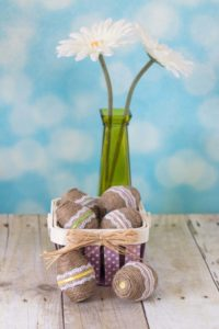 DIY Twine Wrapped Plastic Easter Eggs with Lace and Ribbon | https://www.roseclearfield.com