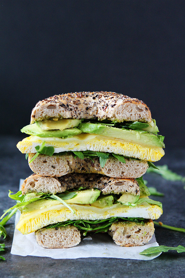 Breakfast for Dinner Ideas - Egg Avocado and Pesto Bagel Sandwich via Two Peas and Their Pod | http://www.roseclearfield.com