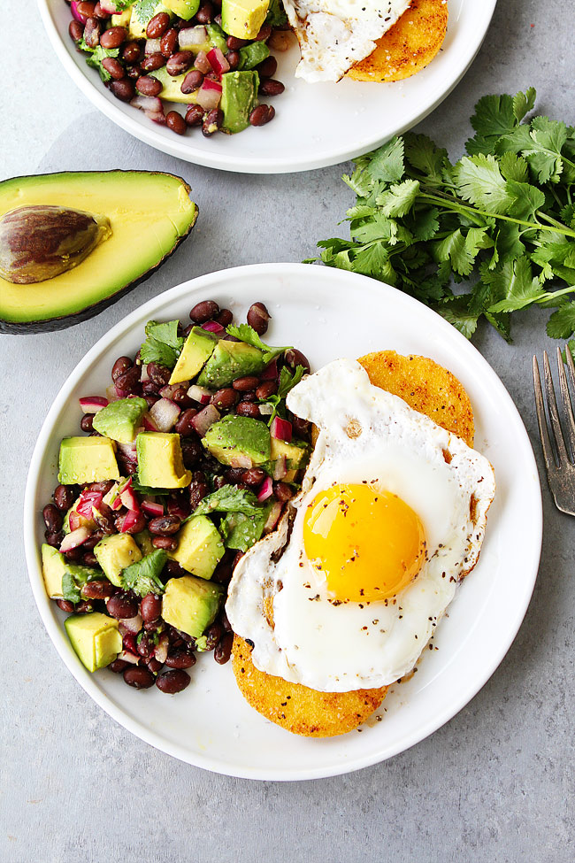 Breakfast for Dinner Ideas - Polenta Rounds with Fried Eggs and Avocado Bean Salsa via Two Peas and Their Pod | http://www.roseclearfield.com