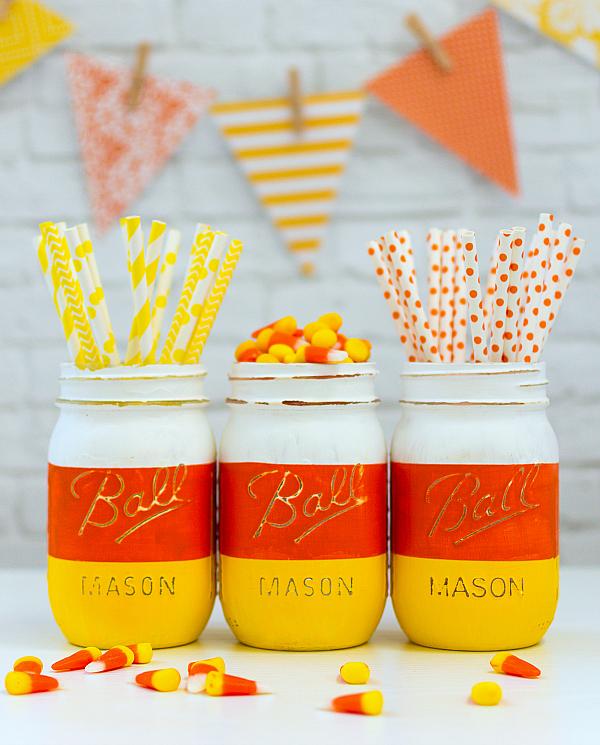 DIY Halloween Mason Jar Decor - Candy Corn Mason Jars for Halloween via Mason Jar Crafts Love | http://www.roseclearfield.com