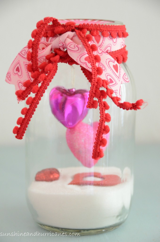 DIY Valentine's Day Mason Jars - Snow Filled Ribbon Tied Valentine's Day Mason Jars via Sunshine and Hurricanes | https://www.roseclearfield.com