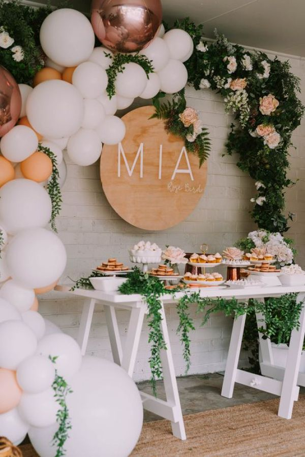 Gorgeous balloon and floral arch over a food display, perfect for a baby shower. #floral #babyshower #balloonarch   https://www.roseclearfield.com