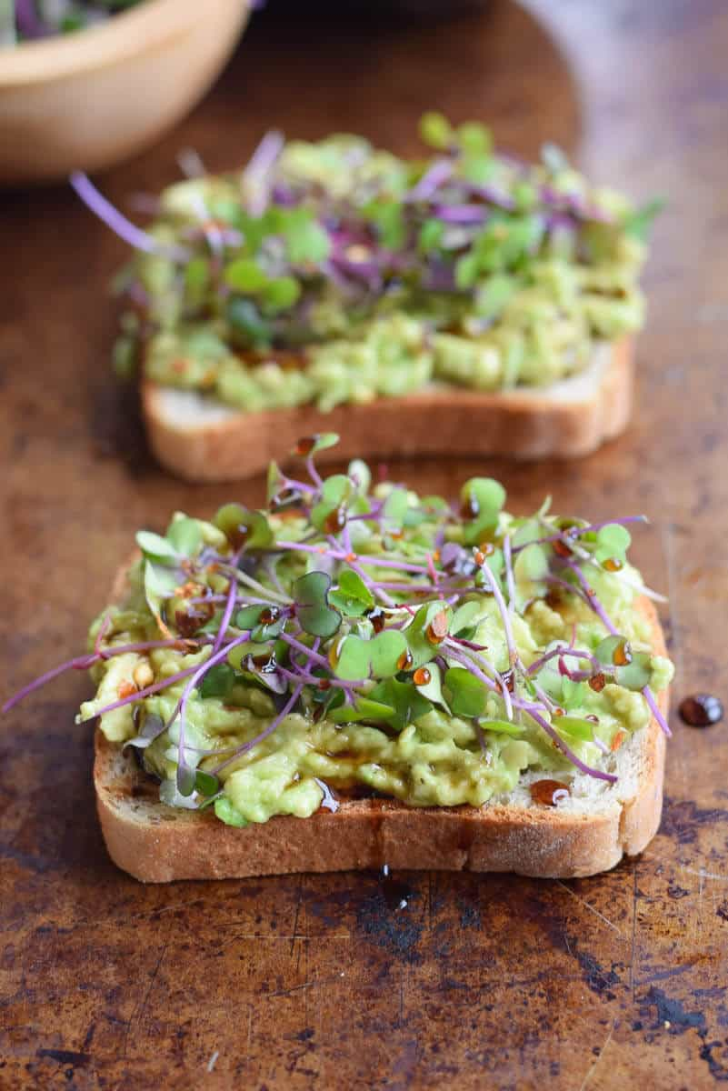 Avocado toast topped with microgreens. Delicious spring breakfast or lunch! via Seasonal Cravings #avocadotoast #healthyeating #healthybreakfast | https://www.roseclearfield.com
