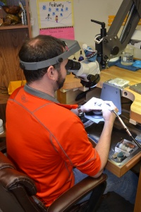 Our in-house Goldsmith, Jordan Rose, at work on repairs.