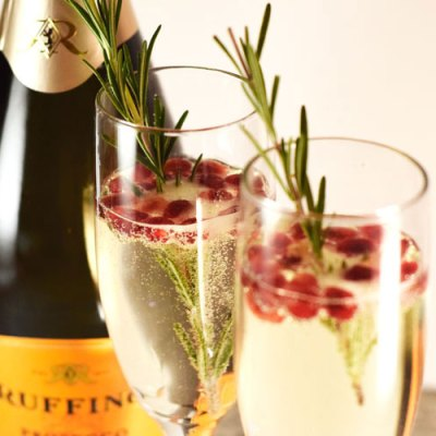 Pomegranate Rosemary Champagne Cocktail