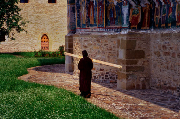 Romanian nun calls prayers with a mallet and wooden plank