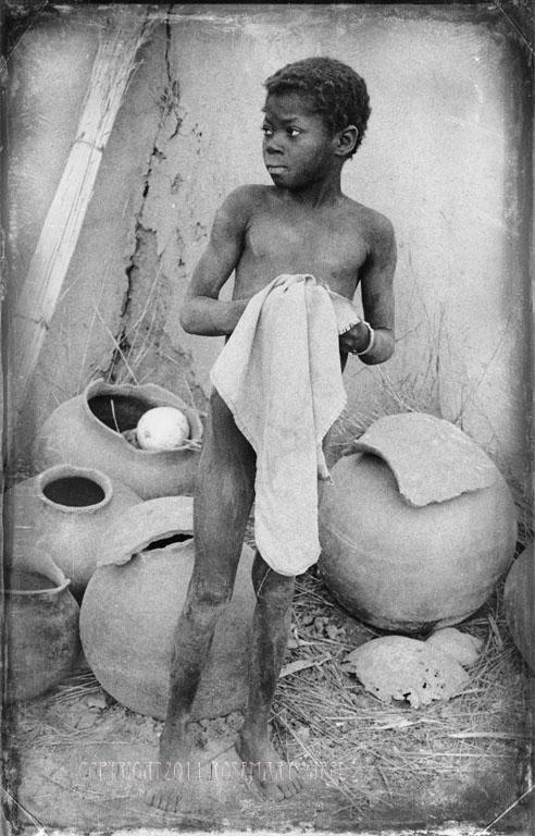 Lobe boy holding cloth