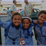Egyptian grammar school girls dressed in school uniform mug for the camera