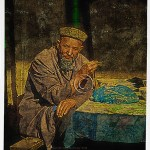 Uighur man holding chopsticks