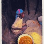 A Somba woman grinds pulses