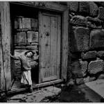 Konya Turkey: girl stands in doorway of old house
