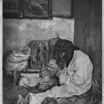 Man polishing fossils in Erfoud Morocco